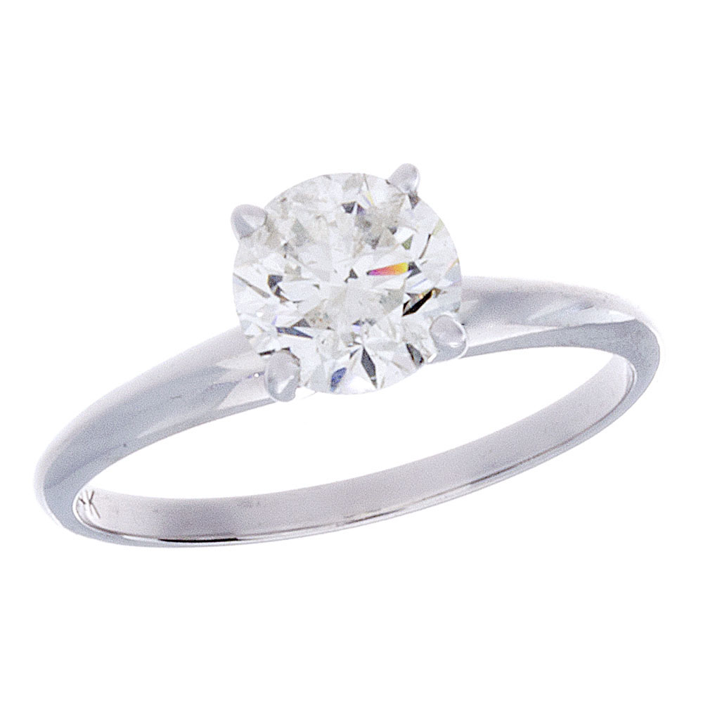 This 14 karat white gold solitaire ring features a 1.13 carat round diamond.  I color, I2 clarity, C cutting